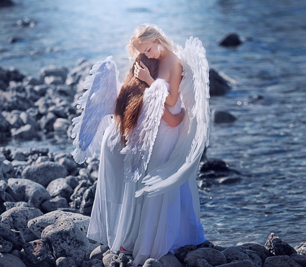 Angels. Mom and daughter with white wings