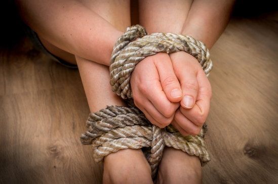Kidnapped Woman Tied With Rope On Wooden Floor