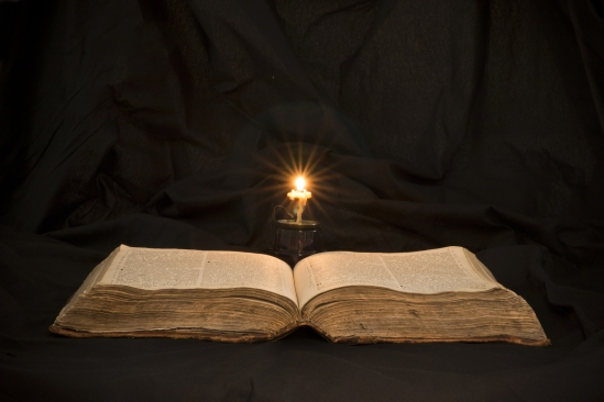 Open Book With Light Spotlight On Text. Reading Of Opened Book E