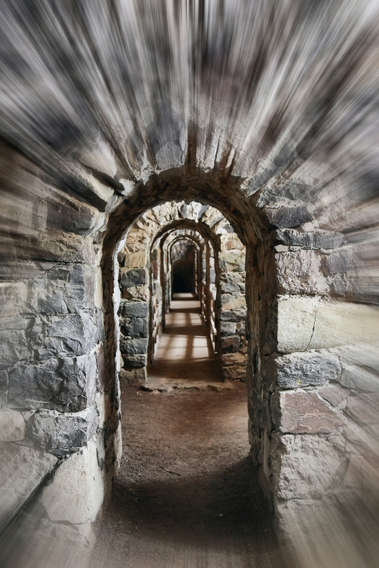 Old stone arch in a castle with rushing motion blur