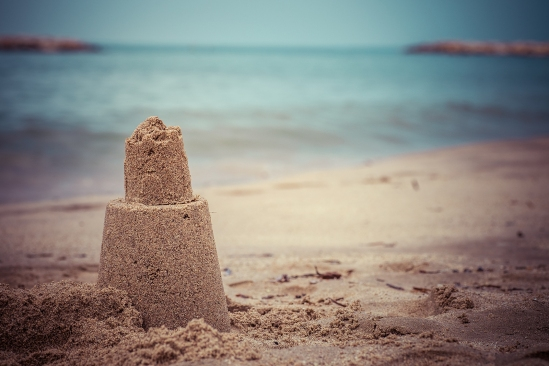 Persistent Tower Of The Sand Castle Washes Away In The Sea Water