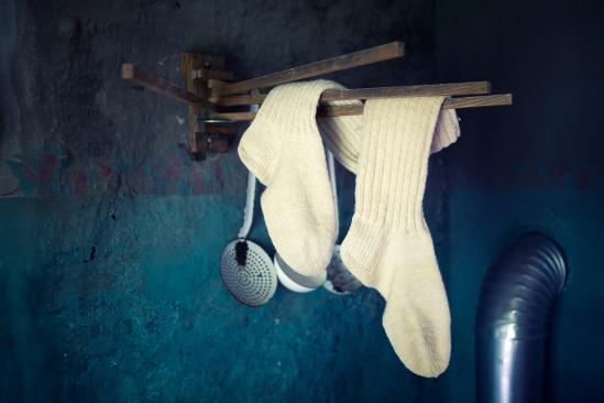 Old White Socks Hanging On Clothesline In Vintage Kitchen