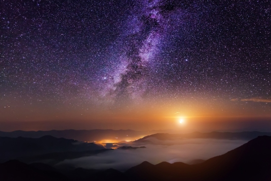 Mountain scene with twilight sky, Moon and shining stars of Milky Way.
