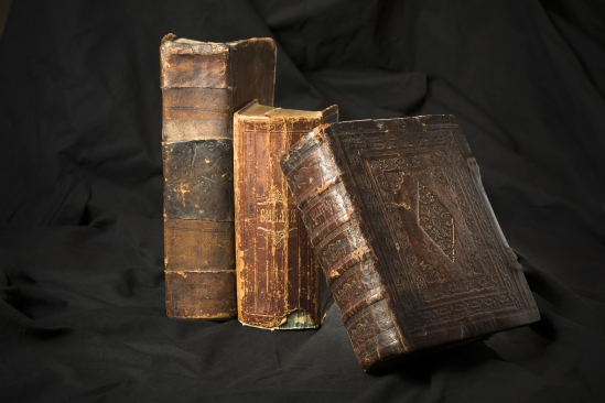 Old Book Spines On Black Background. Ancient Library. Antique Ho