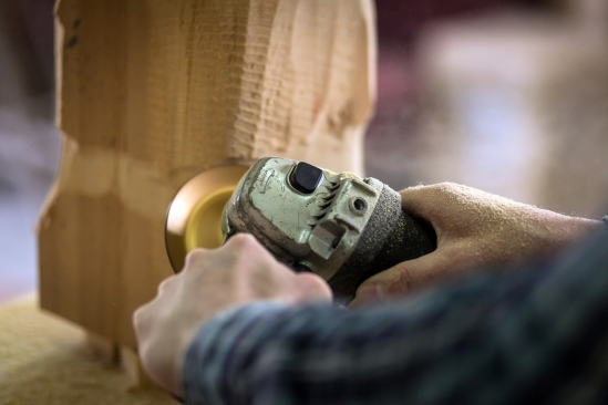 Close Up Of Experienced Carpenter In Work Clothes And Small Buin